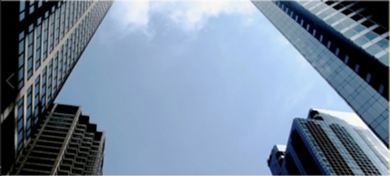Photo of a view looking up into the sky with the tops of tall buildings in sight